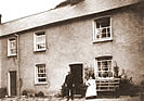 John & Lydia Braund (nee Saunders) outside their Bucks Mills Cottage circa 1910
